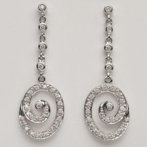 Pavé set diamond spiral drops in 9 carat white gold.