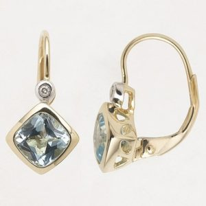 Blue topaz and diamond drop earrings featuring 'European' style clips in 9 carat yellow gold.