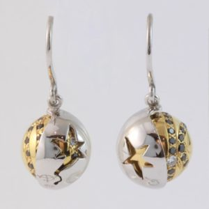 18 carat white and yellow gold 'Eclipse' hook earrings, set with black and white diamonds, with a rotating outer white gold shell