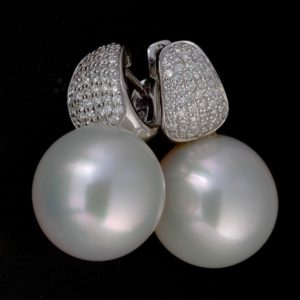 18 carat white gold South Sea pearl and pavè diamond earrings.
