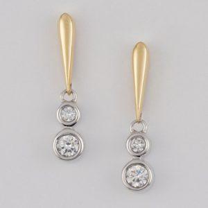 18 carat yellow and white gold diamond drop earrings.