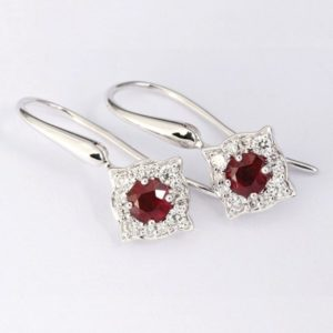 White gold ruby and diamond drop earrings.
