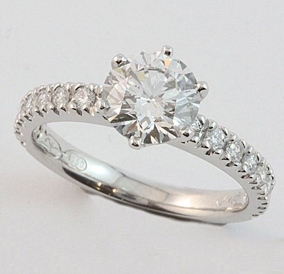18 carat white gold claw set diamond engagement ring, set with a 1.30ct diamond and sixteen diamonds in the shoulders.